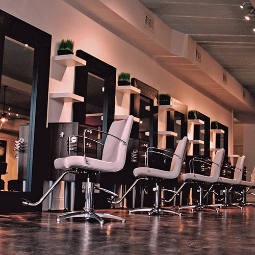Row of salon chairs and mirrors.